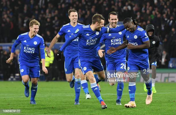 Nampalys Mendy of Leicester City celebrates with Jamie Vardy Christian Fuchs and their team mates after scoring a penalty during a penalty shoot out...