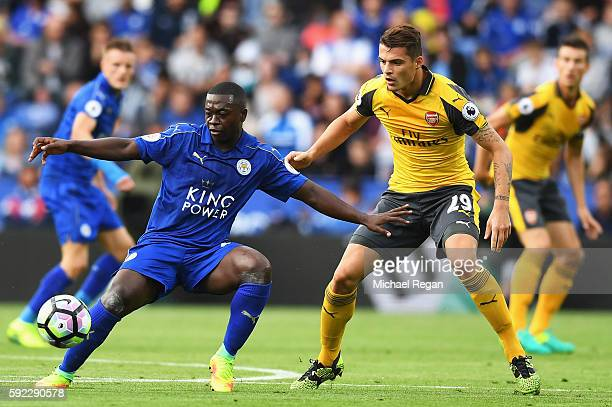 Nampalys Mendy of Leicester City holds off Granit Xhaka of Arsenal during the Premier League match between Leicester City and Arsenal at The King...