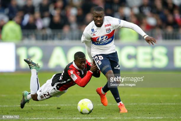 Nampalys Mendy of Nice Tanguy Ndombele Alvaro of Olympique Lyon during the French League 1 match between Nice v Olympique Lyon at the Allianz Riviera...