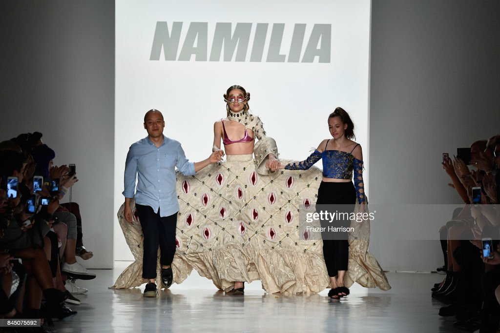 Nan Li, a model, and Emilia Pfohl walk the runway at the Namilia fashion show during New York Fashion Week: The Shows at Gallery 3, Skylight Clarkson Sq on September 9, 2017 in New York City.