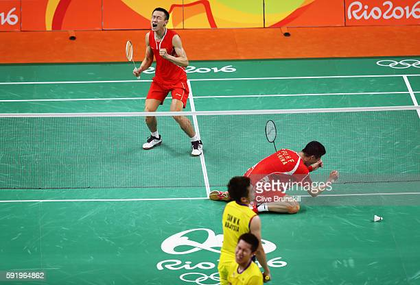 Nan Zhang and Haifeng Fu of China celebrate match point against Wee Kiong Tan and Shem V Goh of Malaysia during the Men's Badminton Doubles Gold...