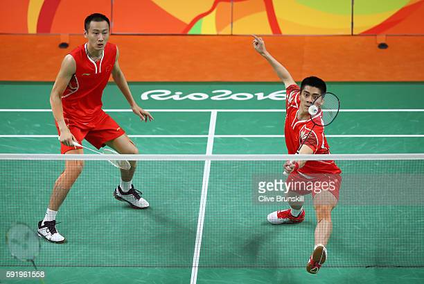 Nan Zhang and Haifeng Fu of China compete against Wee Kiong Tan and Shem V Goh of Malaysia during the Men's Badminton Doubles Gold Medal Match on Day...