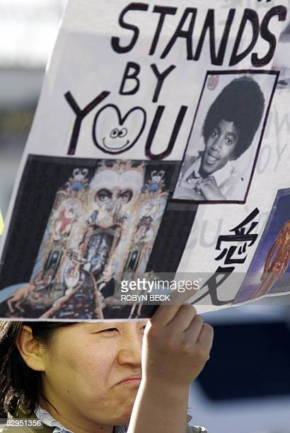 Nana, a Japanese fan of Michael Jackson who would only give her first name, holds a sign of support for the US pop star outside the Santa Barbara...