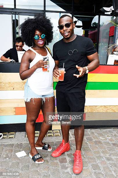 Nana Acheampong and a guest attend the Converse party at Notting Hill Carnival to celebrate the new carnival inspired Converse Custom Chuck Taylor...