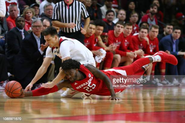 Nana Akenten of the Nebraska Cornhuskers and Peter Kiss of the Rutgers Scarlet Knights dive for a loose ball during the first half of a game at...