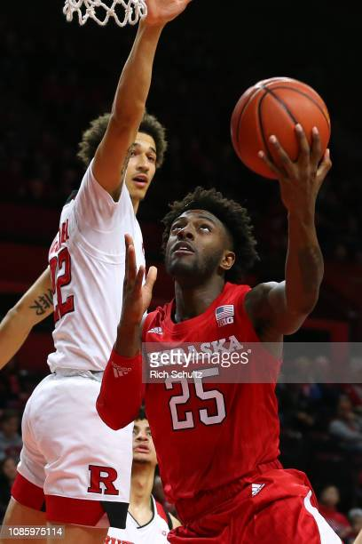 Nana Akenten of the Nebraska Cornhuskers attempts a layup as Caleb McConnell of the Rutgers Scarlet Knights defends during the first half of a game...