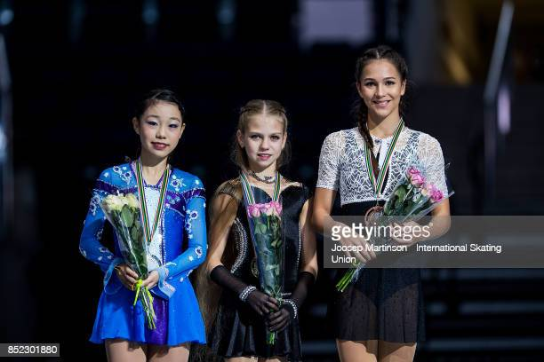 Nana Araki of Japan Alexandra Trusova of Russia and Stanislava Konstantinova of Russia pose in the Junior Ladies medal ceremony during day three of...