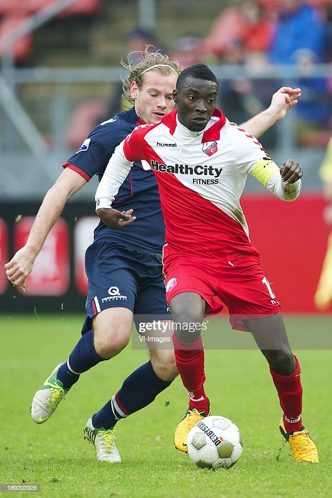 Nana Asare of FC Utrecht, Niek Vossebelt of Willem II during the Dutch Eredivise match between FC Utrecht and Willem II at the Galgenwaard Stadium on January 27, 2013 in Utrecht, The Netherlands.