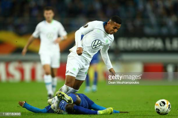 Nana Asare of Gent tackles Joao Victor of VfL Wolfsburg during the UEFA Europa League group I match between KAA Gent and VfL Wolfsburg at Ghelamco...