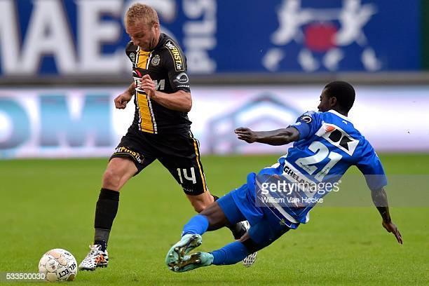 Nana Asare of KAA Gent tackles Jordan Remacle of Sporting Lokeren OVL during the Jupiler Pro League match between KAA Gent and Sporting Lokeren in...