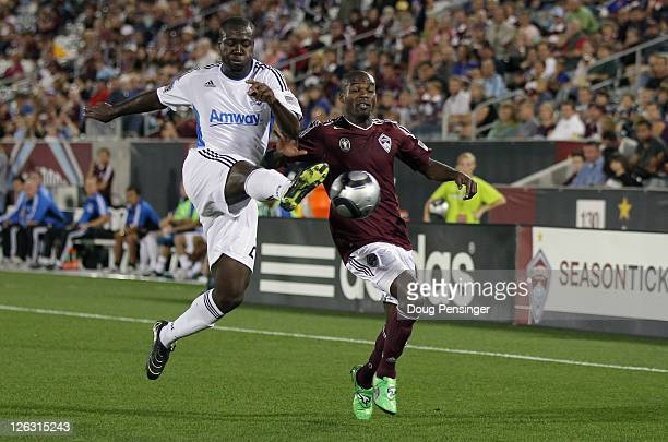 Nana Attakora of the San Jose Earthquakes kicks the ball away from Omar Cummings of the Colorado Rapids at Dick's Sporting Goods Park on September 24...