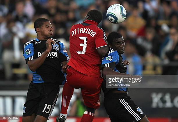 Nana Attakora of the Toronto FC battles for the ball with Ryan Johnson and Brandon McDonald of the San Jose Earthquakes during an MLS game at Buck...