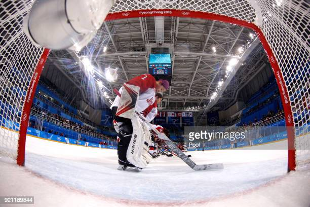 Nana Fujimoto of Japan bows with teammates after being defeated by Switzerland 10 during the Women's Ice Hockey Classification game on day eleven of...