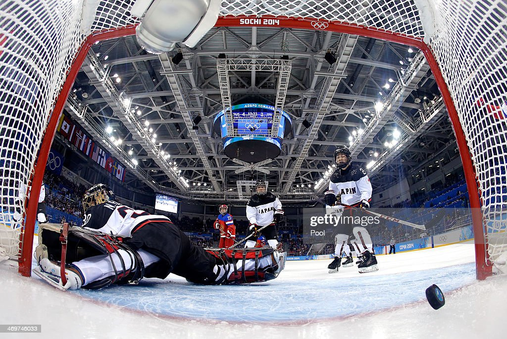 Nana Fujimoto #30 of Japan gives up a goal by Galina Skiba #55 of Russia in the third period during the Women's Ice Hockey Classification game on day nine of the Sochi 2014 Winter Olympics at Shayba Arena on February 16, 2014 in Sochi, Russia.