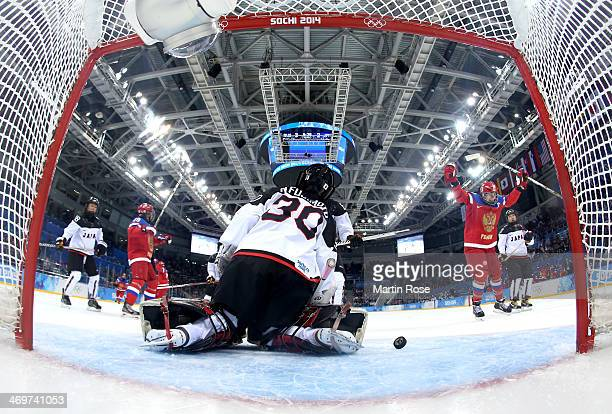 Nana Fujimoto of Japan gives up a goal to Olga Sosina of Russia as Yekaterina Smolentseva celebrates in the second period during the Women's Ice...