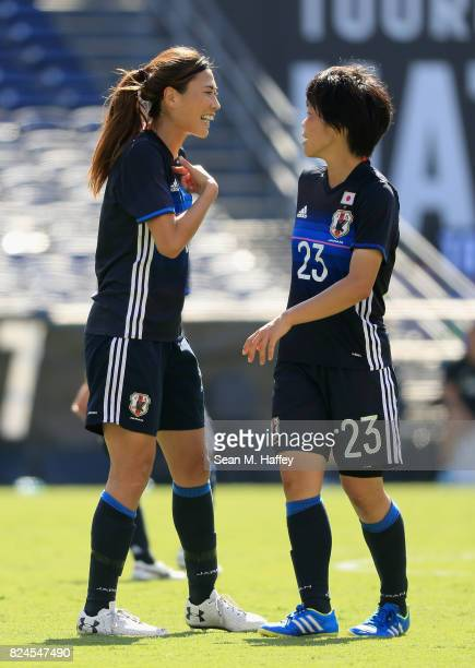 Nana Ichise and Rumi Utsugi talk during the second half of a match against Australia in the 2017 Tournament of Nations at Qualcomm Stadium on July 30...