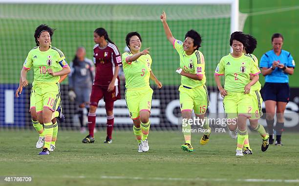 Nana Ichise of Japan celebrate wiith her team mates after scoring the 2nd goal during the FIFA U17 Women's World Cup 2014 semi final match between...