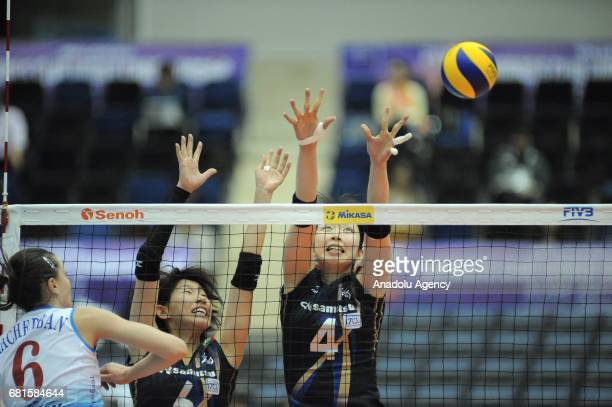 Nana Iwasaka and Yuki Ishii of Hisamitsu Spring in action against Yana Shcherban of Dinamo Moscow during the pool match of the FIVB Womens Club World...