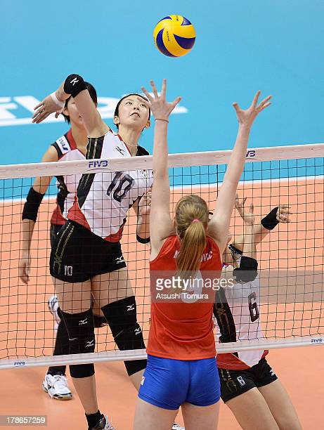 Nana Iwasaka of Japan spikes the ball during day three of the FIVB World Grand Prix Sapporo 2013 match between Serbia and Japan at Hokkaido...