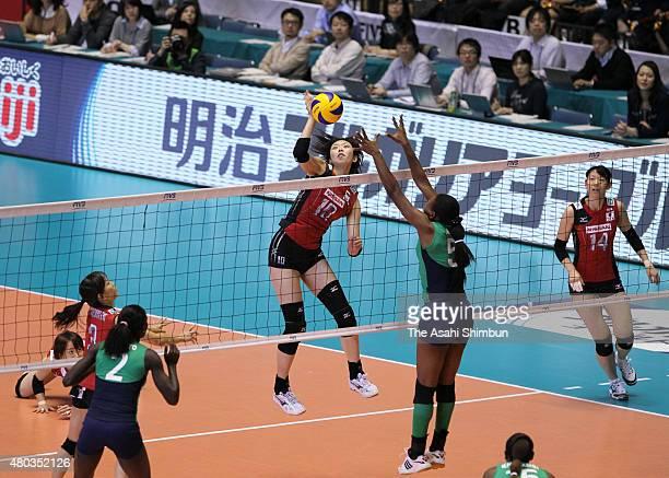 Nana Iwasaka of Japan spikes the ball during the FIVB Women's World Cup fourth round match between Japan and Kenya at Yoyogi National Gymnasium on...