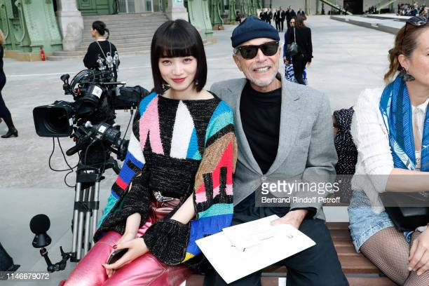 Nana Komatsu and Jean-Paul Goude attend the Chanel Cruise Collection 2020 : Front Row at Le Grand Palais on May 03, 2019 in Paris, France.