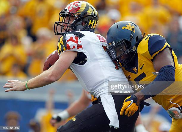 Nana Kyeremeh of the West Virginia Mountaineers hurries quarterback Caleb Rowe of the Maryland Terrapins in the first quarter during the game on...