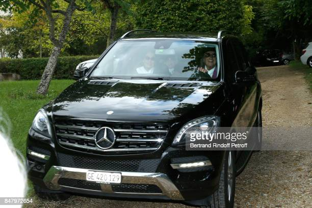 Nana Mouskouri and Andre Chapelle arrive at the Garden Party organized by Bruno Finck companion of JeanClaude Brialy at Chateau De Monthyon on...