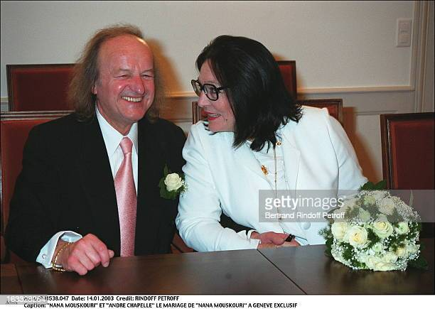 """Nana Mouskouri and """"Andre Chapelle"""" the wedding of """"Nana Mouskouri"""" in Geneva seated bouquet of flowers."""