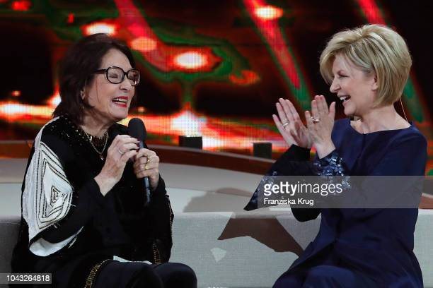 Nana Mouskouri and Carmen Nebel during the television show 'Willkommen bei Carmen Nebel' at Velodrom on September 29 2018 in Berlin Germany