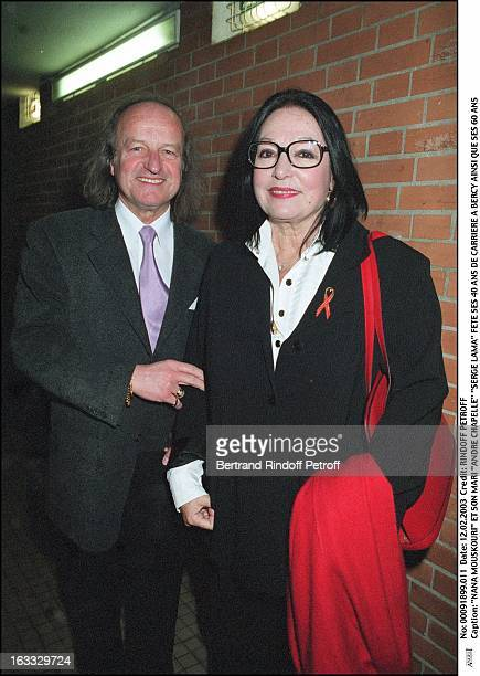 """Nana Mouskouri and her husband """"Andre Chapelle"""" """"Serge Lama"""" celebrate his 40 years career as well as his 60th birthday couple hand bag glasses."""
