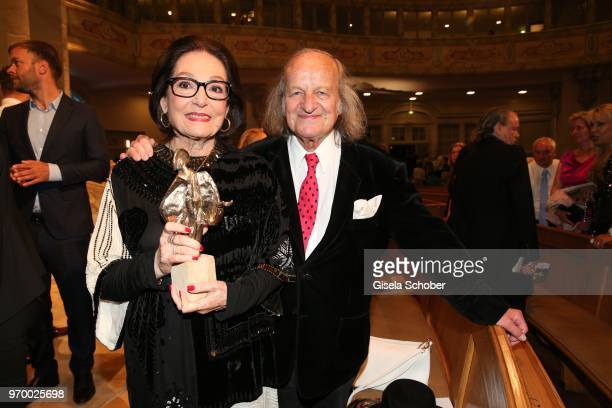 Nana Mouskouri and her husband Andre Chapelle with her award during the European Culture Awards TAURUS 2018 at Dresden Frauenkirche on June 8 2018 in...