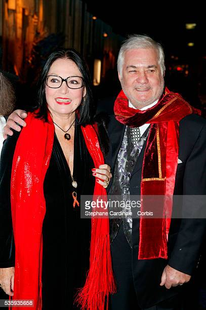 Nana Mouskouri and JeanClaude Brialy arriving at Elton John's concert at the Lido in Paris