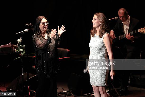 Nana Mouskouri and Lenou Mouskouri perform on stage at Royal Albert Hall on September 25 2014 in London United Kingdom