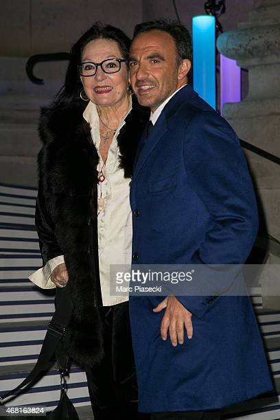 Nana Mouskouri and Nikos Aliagas attend the 'Jean Paul Gaultier' exhibition opening cocktail at Grand Palais on March 30 2015 in Paris France