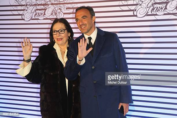 Nana Mouskouri and Nikos Aliagas attend the Jean Paul Gaultier Exhibition photocall at Grand Palais on March 30 2015 in Paris France