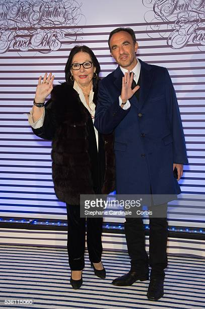 Nana Mouskouri and Nikos Aliagas attend the 'Jean Paul Gaultier Exhibition' Photocall At Grand Palais at Grand Palais on March 30 2015 in Paris France