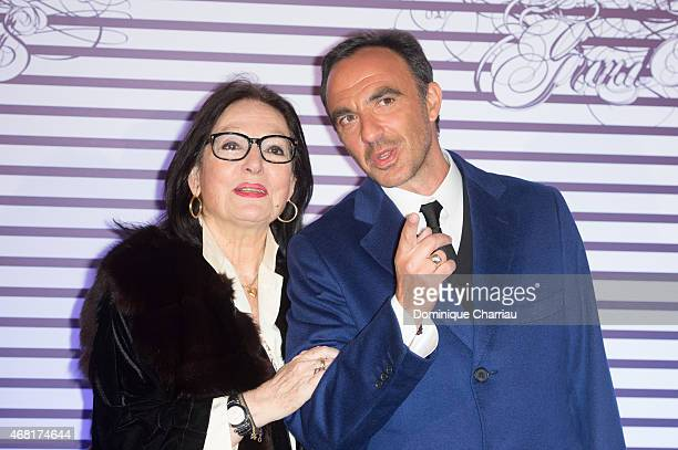 Nana Mouskouri and Nikos attend the Jean Paul Gaultier Exhibition' Photocall at Grand Palais on March 30 2015 in Paris France