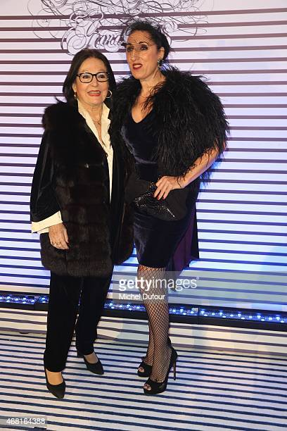 Nana Mouskouri and Rossy De Palma attend the Jean Paul Gaultier Exhibition photocall at Grand Palais on March 30 2015 in Paris France
