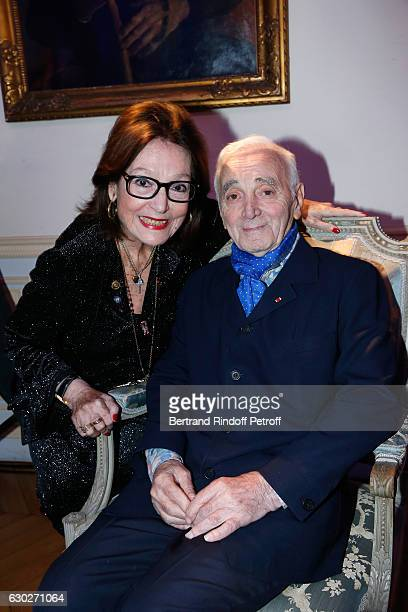"""Nana Mouskouri gives the Greek Prize """"Nikos Gatsos 2016"""" to Charles Aznavour at Embassy of Greece on December 19, 2016 in Paris, France."""