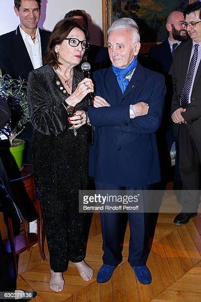 Nana Mouskouri gives the Greek Prize 'Nikos Gatsos 2016' to Charles Aznavour at Embassy of Greece on December 19 2016 in Paris France
