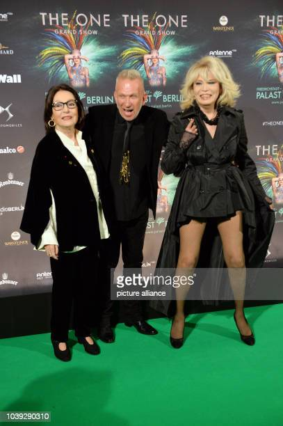 Nana Mouskouri Jean Paul Gaultier and Amanda Lear arrive for the premiere of new show The One at the FriedrichstadtPalast in Berlin Germany 6 October...