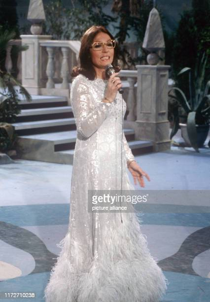 """Nana Mouskouri on 18 February 1983 in Hanover in her show """"Zu meinem Glück gehört Musik"""".The greek singer and politician was born an 13 October 1934...."""