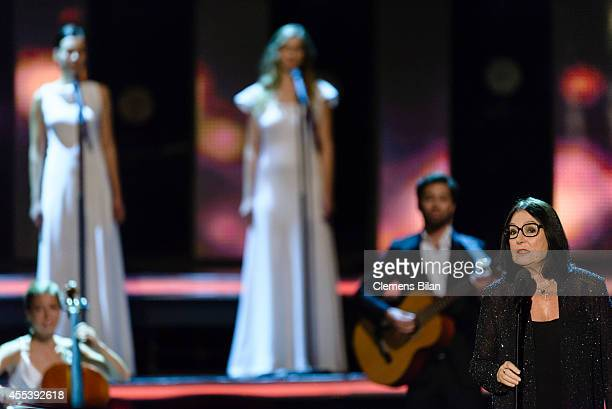 Nana Mouskouri performs at the 'Willkommen bei Carmen Nebel' show at Velodrom on September 13 2014 in Berlin Germany