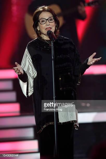 Nana Mouskouri performs during the television show 'Willkommen bei Carmen Nebel' at Velodrom on September 29, 2018 in Berlin, Germany.
