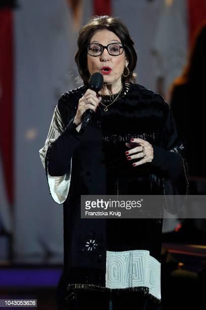 Nana Mouskouri performs during the television show 'Willkommen bei Carmen Nebel' at Velodrom on September 29 2018 in Berlin Germany