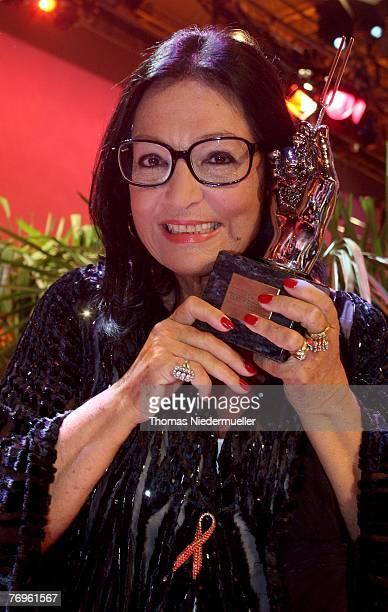 Nana Mouskouri poses for the media after the recording of TV show 'Die goldene Stimmgabel 2007' presented by Dieter Thomas Heck in the...