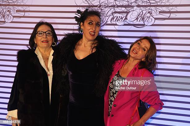 Nana Mouskouri Rossy De Palma and Victoria Abril attend the Jean Paul Gaultier Exhibition photocall at Grand Palais on March 30 2015 in Paris France