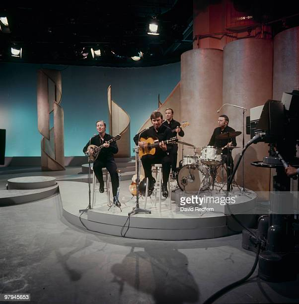 Nana Mouskouri's backing group The Athenians with her husband George Petsilas on guitar perform on a television show in the 1970's