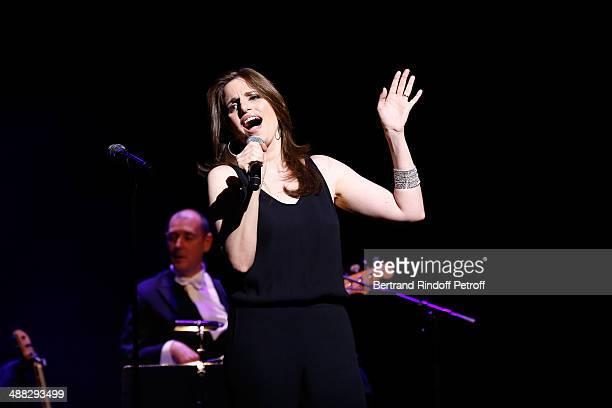 Nana Mouskouri's daughter Lenou Petsilas performs at Nana Mouskouri's Happy Birthday Tour Held at 'Theatre du Chatelet' on March 10 2014 in Paris...