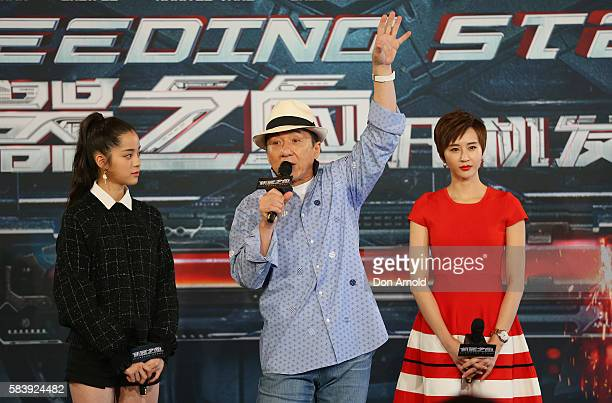 Nana Ouyang and Erica Xiahou look on as Jackie Chan addresses media during a press conference and photocall for Bleeding Steel at Sydney Opera House...
